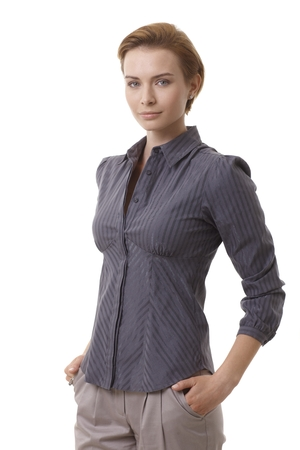 gingerish: Portrait of attractive young businesswoman standing hands in pockets.
