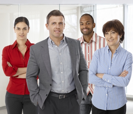 business casual: Diverse team of smiling office workers. Boss and employees of successful casual small business.
