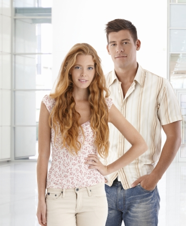 Portrait of attractive young couple, smiling, looking at camera. Stock Photo - 24964575