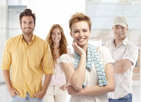 Portrait of happy young men and women, smiling, looking at camera. Stock Photo - 24966462