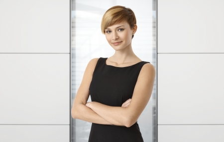 gingerish: Attractive businesswoman at office. Copyspace on both sides. Stock Photo