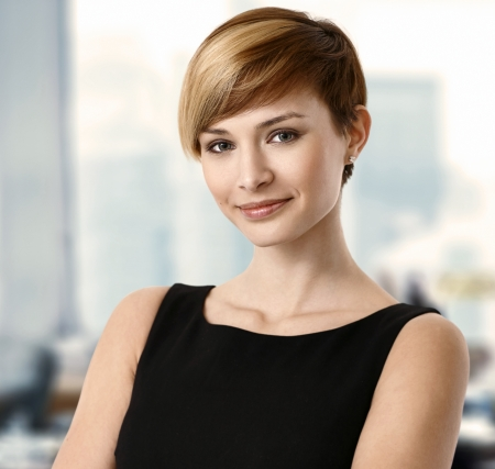 Closeup portrait of attractive young businesswoman.