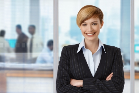 Portrait of happy elegant businesswoman at office, copyspace on left. photo