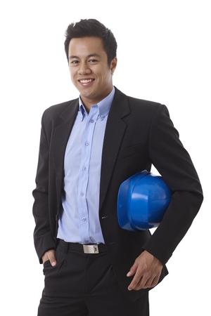 asian architect: Happy smiling Asian architect holding hardhat, looking at camera.