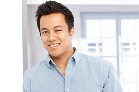 Closeup portrait of happy young Asian man photo