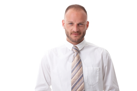 Close-up portrait of handsome businessman smiling, looking at camera, wearing white shirt and tie. Stock Photo