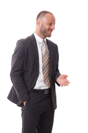 Happy businessman turning left, talking, gesturing, smiling. photo