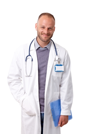 Portrait of handsome young doctor in lab coat, smiling, looking at camera. photo