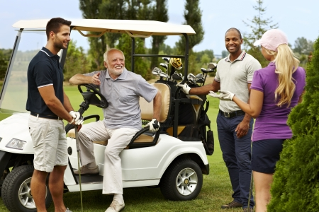 golfing: Happy companionship ready for golfing around golf cart.