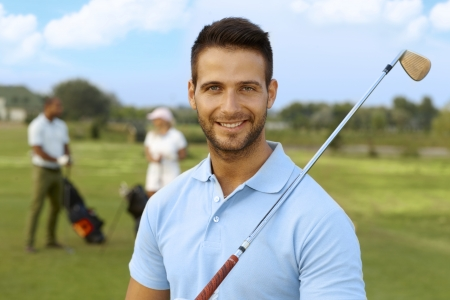 and the horizontal man: Closeup portrait of handsome young male golfer with golf club. Stock Photo
