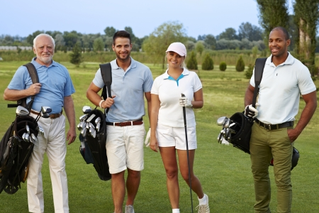 Happy companionship smiling on golf course. Stock Photo