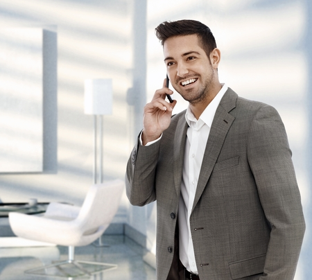 Happy businessman calling with mobile phone. Stock Photo - 25640549