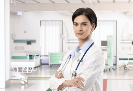 beauty center: Attractive caucasian female doctor at hospital room, smiling.