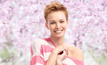 Happy young woman at spring looking at camera, smiling. photo