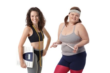 As mulheres com sobrepeso e magros ter dieta juntos para estar em forma e saud Imagens