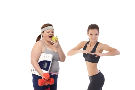 Overweight and slim women having diet together to be fit and healthy. photo
