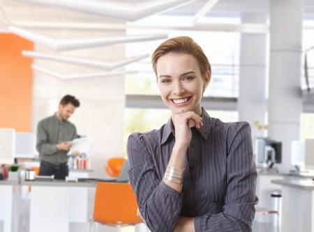gingerish: Happy caucasian businesswoman in modern office. Stock Photo