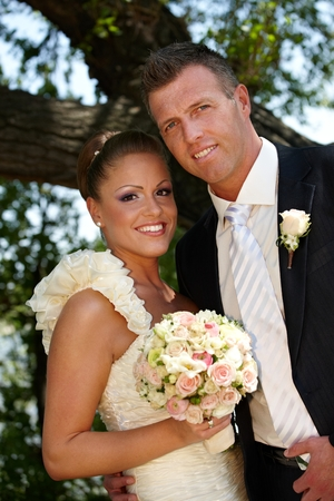 Happy young couple smiling on wedding-day, looking at camera. Stock Photo - 25711157