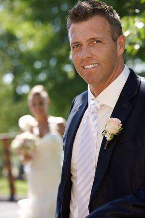 Outdoor portrait of happy groom on wedding-day. photo