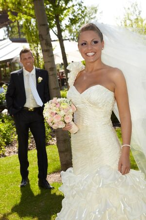 Beautiful woman in wedding gown smiling happy on wedding-day, wearing long veil Stock Photo - 25711301