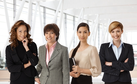 working attire: Diverse group of businesswomen of different ethnicity and age at office. Stock Photo