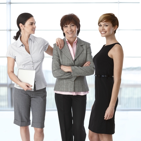 Team portrait of group of businesswomen of diverse age. Stock Photo