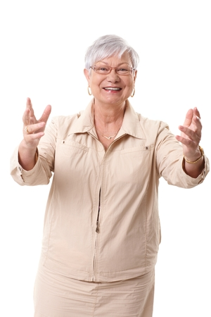 outspreading: Happy grandmother greeting someone with arms wide open.