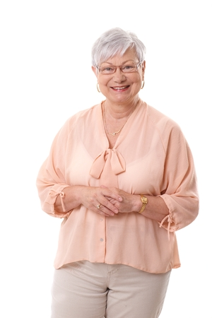 Portrait of happy smiling mature woman over white background.