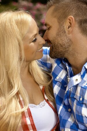 be kissed: Happy casual romantic couple kissing. Attractive blonde caucasian woman and handsome stubbly man. Stock Photo