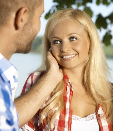 Happy attractive casual blonde smiling caucasian romantic woman caressed outdoor.