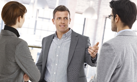 Happy businesspeople discussing at office. Stock Photo - 26368730