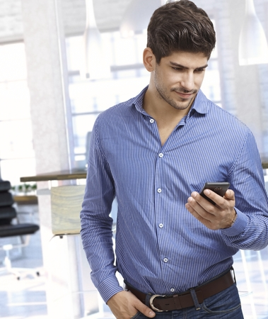Young man looking at mobile phone photo