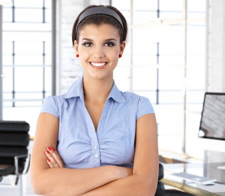Happy caucasian businesswoman at office desk, smiling. Stock Photo - 26738946