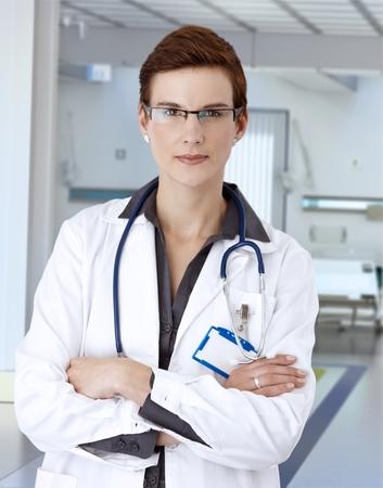 Confident short haired female doctor on hospital corridor. Stock Photo - 26739093