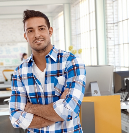 Portrait of casual man at office, looking at camera smiling. Stock Photo - 26739094