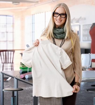scandinavian people: Portrait of happy casual trendy caucasian blonde fashion designer woman at studio. Smiling, standing, looking at camera.