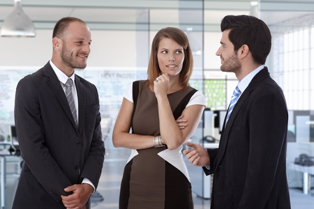 Smiling colleagues discussing at corporate office office. Stock Photo - 27297462
