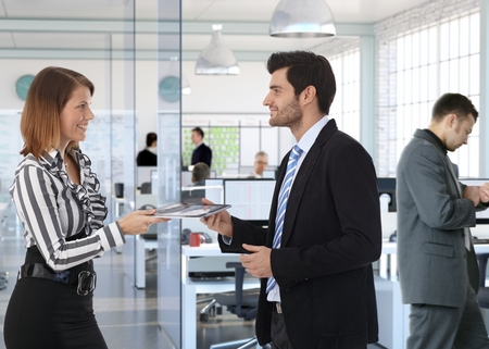 Corporate business people working at office, smiling. Stock Photo - 27297465