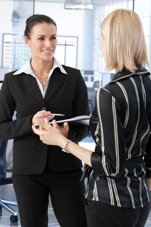 Elegant businesswoman discussing business at office. Stock Photo - 27297469