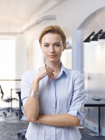gingerish: Portrait of attractive caucasian businesswoman at office Stock Photo