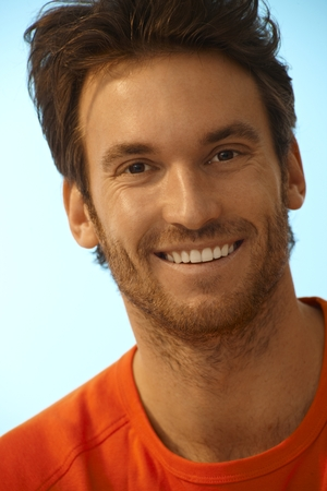 bristly: Portrait of happy handsome casual caucasian man. Smiling, perfect teeth, stubble.