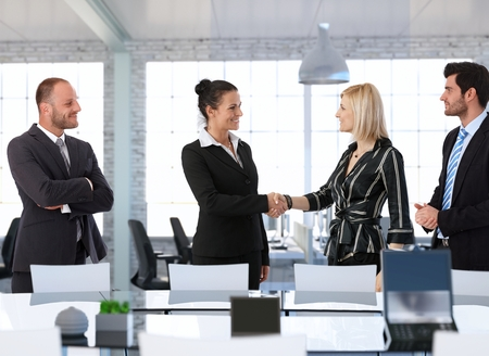 Happy businesswomen shaking hands in office before business meeting. Stock Photo - 28105519