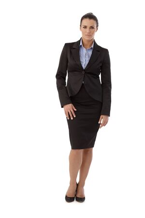 Full size portrait of serious casual brunette caucasian businesswoman wearing suit, standing in front of white background. Looking at camera. Stock Photo - 28345595
