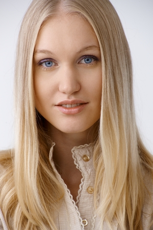 blonde  blue eyes: Closeup portrait of beautiful young woman with long blonde hair and blue eyes.
