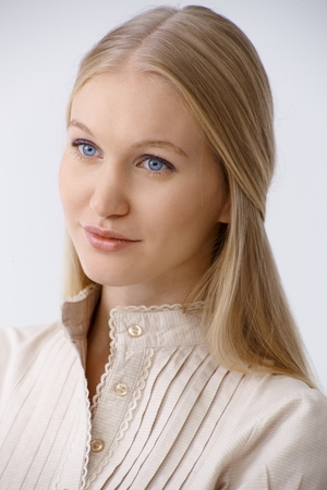 blonde  blue eyes: Portrait of young blonde woman with blue eyes, looking away, daydreaming. Stock Photo