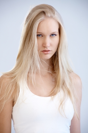 Portrait of beautiful young nordic type woman looking at camera. photo