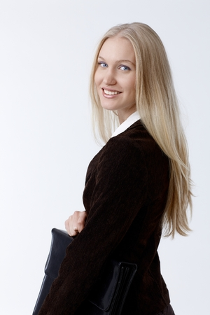 scandinavian people: Portrait of attractive young businesswoman in black holding briefcase smiling happy.
