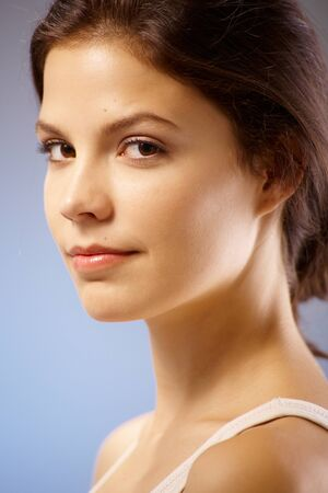 fresh face: Closeup portrait of pure young woman smiling, looking at camera.