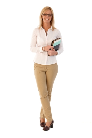 Happy blonde businesswoman holding folders, smiling, looking at camera. Full size. photo
