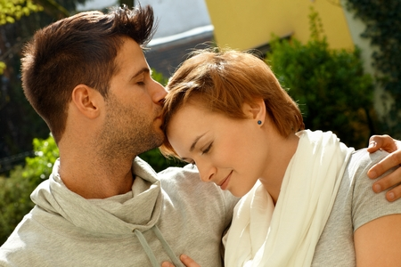 be kissed: Closeup photo of embracing loving couple. Man kissing girlfriend.